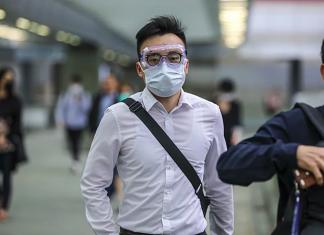 Người Hong Kong đã hình thành văn hoá đeo khẩu trang từ sau đại dịch Sars năm 2003. Ảnh: SCMP.