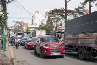 May be an image of car and road